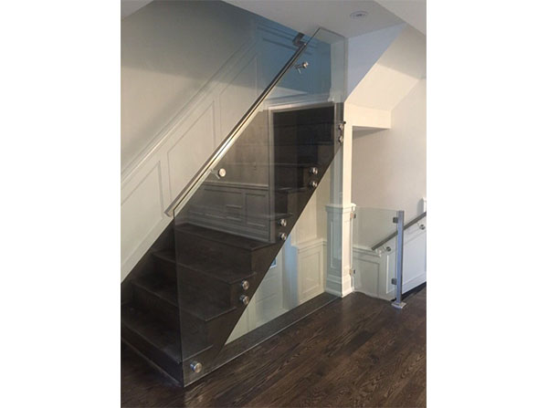 Custom glass panels encasing the staircase