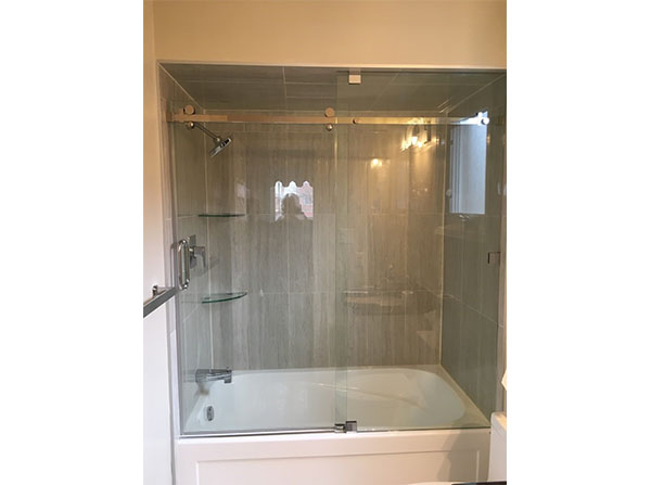 Custom tile & glass shower enclosure with sliding glass door