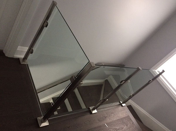 Custom glass wall & staircases with chrome handrails