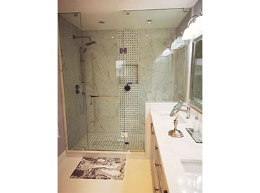 Custom glass shower enclosure and shower niche