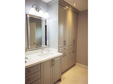 Custom vanity and linen cabinets with Metro style doors