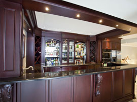 Custom basement bar with built-in bulkhead and lights
