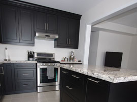 Custom kitchen cabinets in black thermo-laminated MDF with shaker style doors