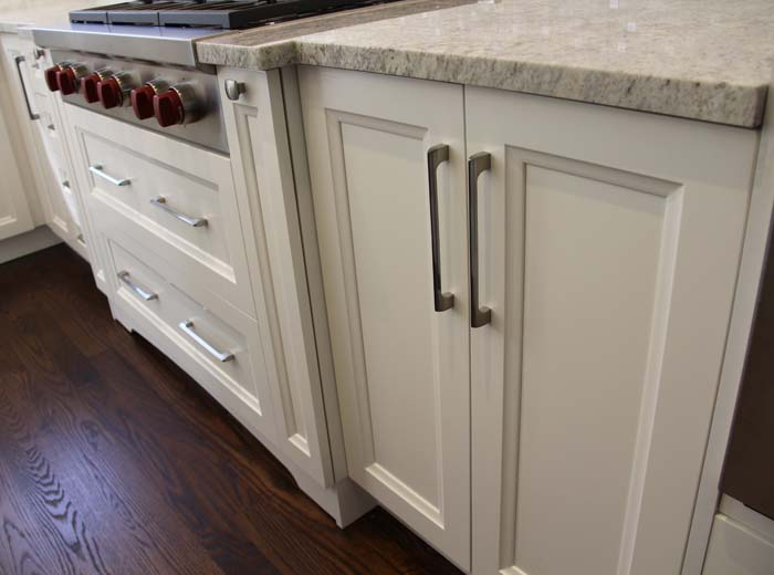 white solid wood custom kitchen with ivory granite